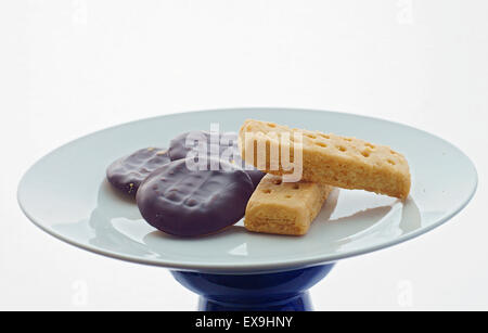 A plate of Jaffa cakes and Scottish shortbread biscuits - Stock Photo