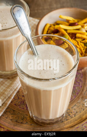 Masala Chai a blend of black tea made with milk and various aromatic spices - Stock Photo