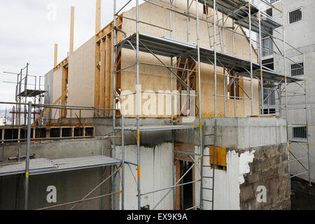 typical construction of timber framed house over block and concrete basement in reykjavik iceland - Stock Photo
