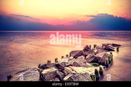 Purple sunset over beach, peaceful sea landscape. - Stock Photo
