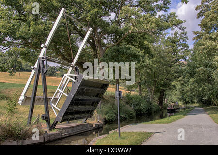 Raised bridge over the llangollen canal ready for the narrow boat to go through - Stock Photo