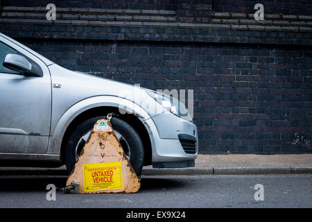 Car clamped for being an untaxed vehicle - Stock Photo