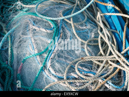 Fishing nets piled in a box after a days fishing - Stock Photo