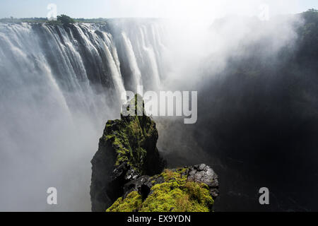 Africa, Zimbabwe, Victoria Falls National Park, Zambezi River as it flows over Victoria Falls - Stock Photo