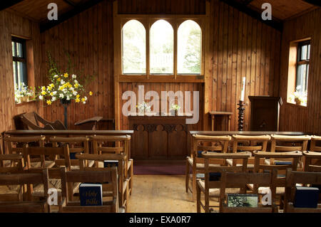 The simple interior of St Catherine's-by-the-sea, a small wooden church perched on a cliff top overlooking Ringstead - Stock Photo