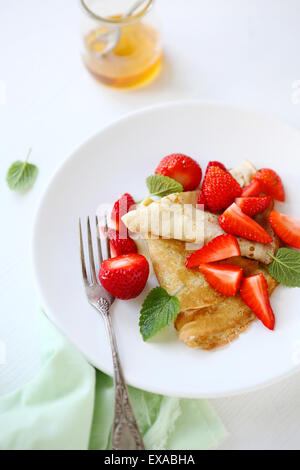 crepe with strawberry and honey, food closeup - Stock Photo