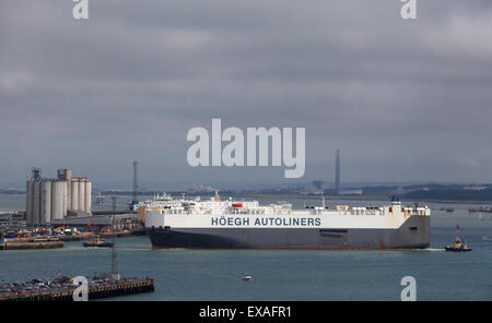 Hoegh Autoliners transporter ship Hoegh Trove pictured leaving Southampton Docks - Stock Photo