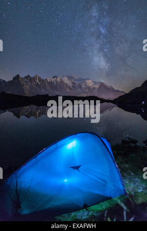 Camping with a tent under the Milky Way at Lac des Cheserys, looking at Mont Blanc, Haute Savoie, French Alps, France, - Stock Photo