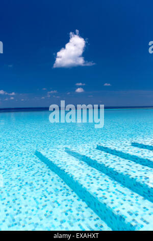 Infinity pool in the Maldives, Indian Ocean, Asia - Stock Photo