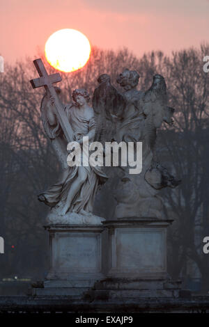 Bernini's breezy maniac angels statues on the Ponte Sant'Angelo at sunrise, Rome, Lazio, Italy, Europe - Stock Photo