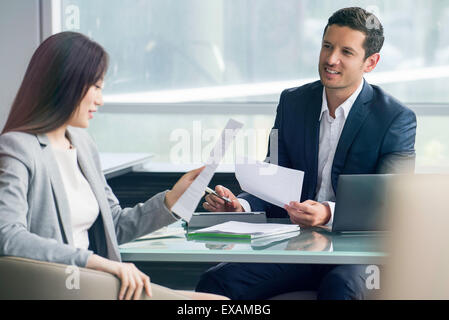 Business associates reviewing document - Stock Photo
