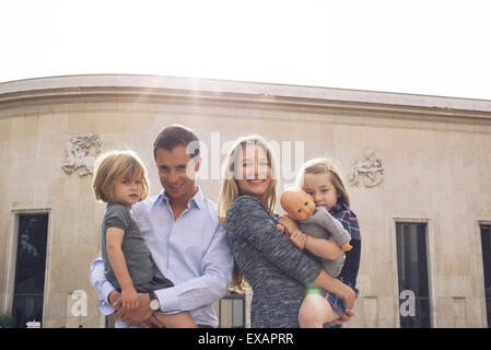 Family together outdoors, portrait - Stock Photo