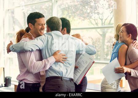 Business associates celebrating team success - Stock Photo