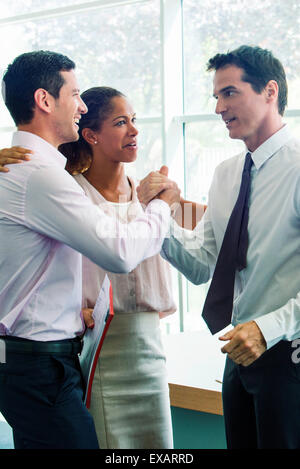 Businessmen congratulating each other - Stock Photo