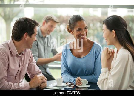 Friends enjoying coffee break - Stock Photo