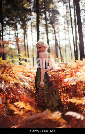 young woman with dress in the woods - Stock Photo