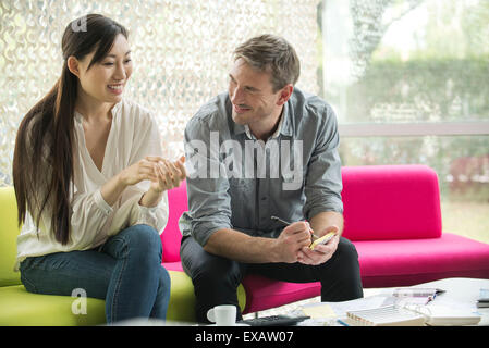 Colleagues looking at color swatches together - Stock Photo