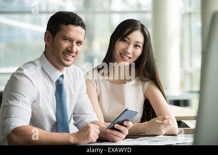 Business associates collaborating, portrait - Stock Photo