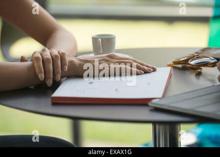 Meeting for coffee, dayplaner on table - Stock Photo