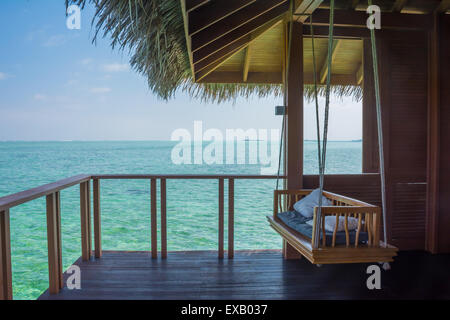 Patio of a water bungalow in an island resort in Maldives - Stock Photo