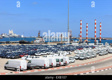 Rows of new cars parked in an international port - Stock Photo