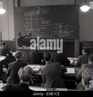 1950s, Historical, interior picture of young male students being taught engineering in a class room. - Stock Photo