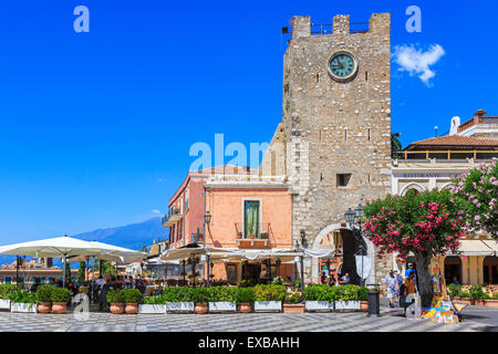 Borgo Medievale Clock tower and San Giuseppe Church  at IX Aprile Square, Corso Umberto, Taormina village, Sicily - Stock Photo
