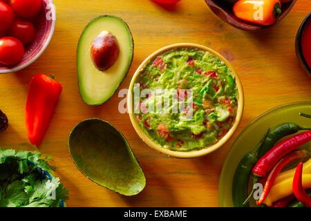 Mexican food mixed guacamole chili sauce avocado tomatoes and coriander - Stock Photo