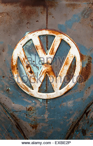 Old and rusty Volkswagen logo badge - Stock Photo