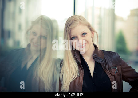 beautiful young blonde woman in the city - Stock Photo