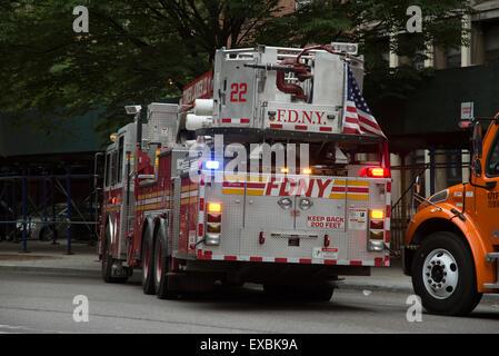 Tower ladder fire truck rear view with flag Manhattan New York USA