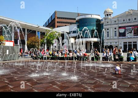 The Playhouse Theatre in Williamson Square with fountains in the foreground and people enjoying the Summer sunshine, - Stock Photo