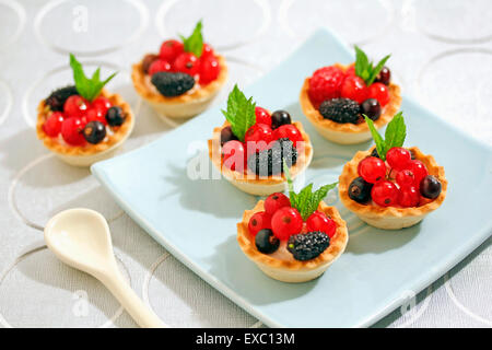 Wild berries tartlets. - Stock Photo