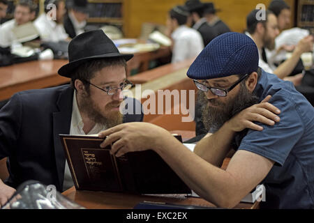 2 religious Jewish boys study together at Lubavitch headquarters in Crown Heights, Brooklyn, New York - Stock Photo