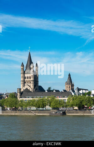 Great St. Martin church and Rhine River in Cologne, Germany - Stock Photo