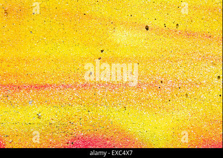 Cracked yellow and orange paint on a stone surface as a background image - Stock Photo