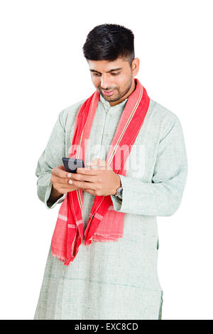 1 indian Rural Farmer man dialing Cell Phone - Stock Photo