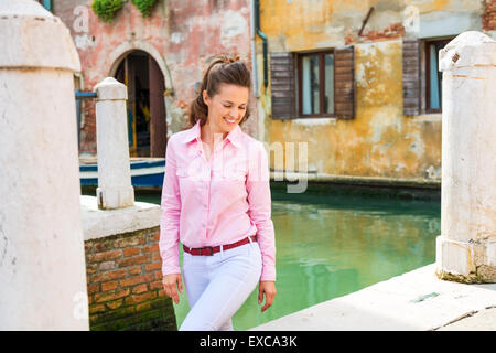 The magic of Venice is best discovered on foot, or on the water along the canals, and the best thing is, that's - Stock Photo