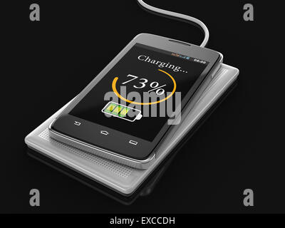 Wireless charging of smartphone (clipping path included) - Stock Photo