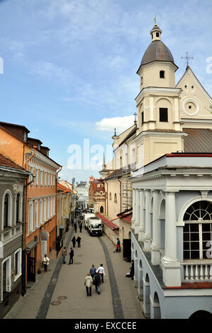 The Church of St Theresa and Ausros Vartu Street seen from the Gate of Dawn in Vilnius. - Stock Photo