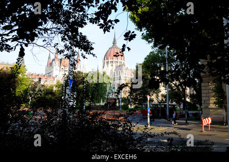 The Hungarian Parliament Building seen through the trees. - Stock Photo