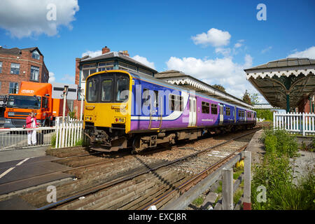 Hale railway station and level crossing, Cheshire UK  Hale is a village and electoral ward within the Metropolitan - Stock Photo