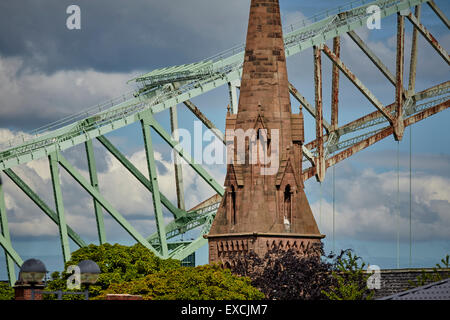 Runcorn is an industrial town and cargo port in Halton, Cheshire, UK.    Pictured The Silver Jubilee Bridge or Runcorn - Stock Photo