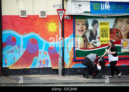 Runcorn is an industrial town and cargo port in Halton, Cheshire, UK.  Pictured Mural on corner shop wall depicting - Stock Photo