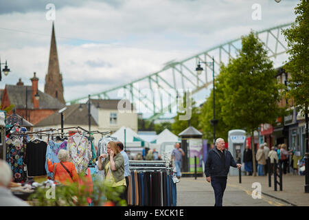 Runcorn is an industrial town and cargo port in Halton, Cheshire, UK.  Pictured Market traders in the town centre - Stock Photo