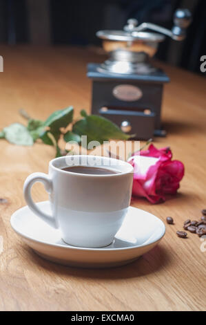 Vintage coffee mill, cup and rose - Stock Photo