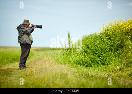 Pictures around Southport   Pictured Ribble Estuary Nature reserve, a photographer photographing the nature   Southport - Stock Photo