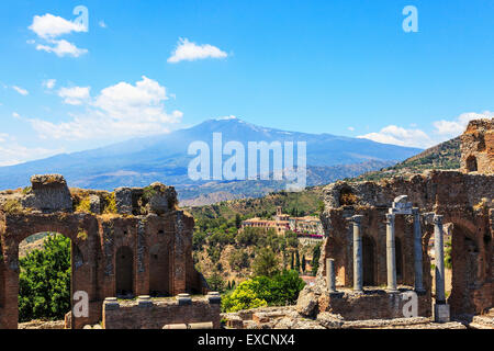Mount Etna from the Greek Roman Amphitheatre in Taormina, Messina district, Sicily, Italy - Stock Photo