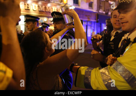 London, UK. 11th July, 2015. Police, anti fascist protesters and attendees of an alleged white pride gig clash in - Stock Photo