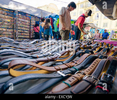 Men shopping for leather belts at the Zocalo market in Oaxaca Mexico - Stock Photo
